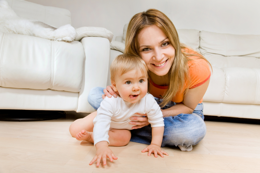 smiling young mother with he
