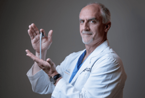 David Schneider MD displays mdeical device for orthopedic surgery